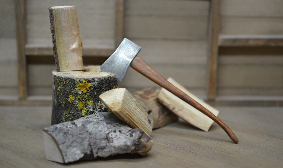 hatchet in woodpile